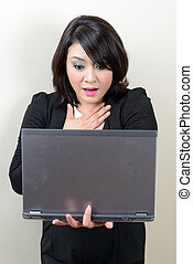 beautiful business woman scared with her laptop screen