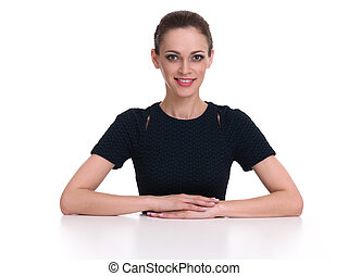 beautiful business woman sits at the desk