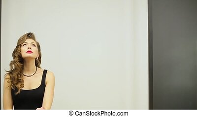 Beautiful business woman smiling on the white wall background