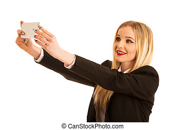 beautiful business woman taking selfie photo with smart phone isolated over white background