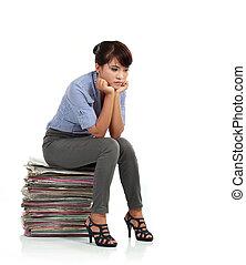 Beautiful business woman thinking about somethinking