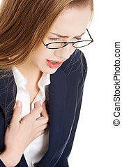 Beautiful business woman touching her chest, feeling unwell....