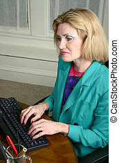 Beautiful Business Woman Typing On Computer