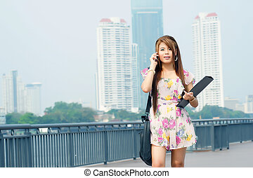 Beautiful business woman walking outside her office. Portrait of asian.