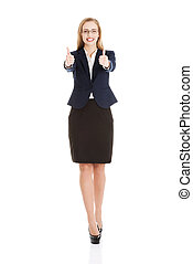 Beautiful business woman with her thumb up, showing oK.