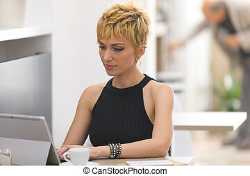 Beautiful business woman working in cafe