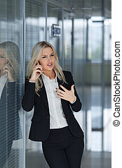 beautiful businesswoman angry and talking on the phone, office manager concept shot