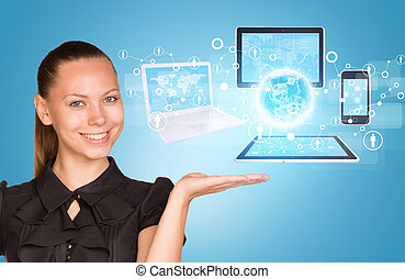 Beautiful businesswoman demonstrating computer equipment.