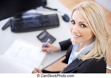 Beautiful businesswoman doing finances