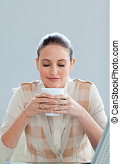 Beautiful businesswoman drinking a coffee