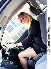 Beautiful businesswoman driving a car