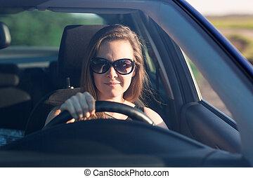 Beautiful businesswoman driving the car