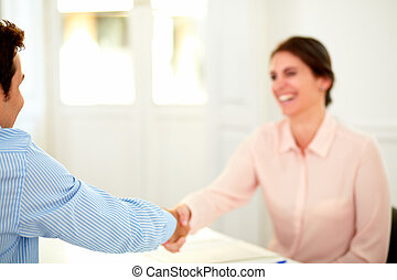 Beautiful businesswoman giving a hand greeting - Portrait of...