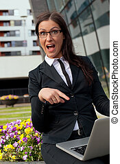 Beautiful businesswoman happy pointing her finger at computer