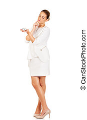 Beautiful businesswoman holding airplane model