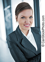 Beautiful businesswoman in office smiling