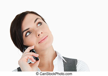 Beautiful businesswoman looking up while phoning