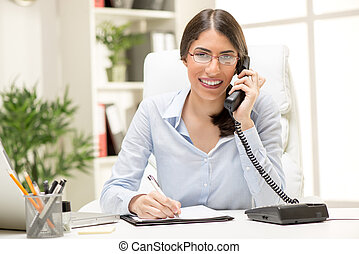 Beautiful Businesswoman Phoning In