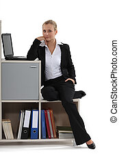 beautiful businesswoman relaxing at her office