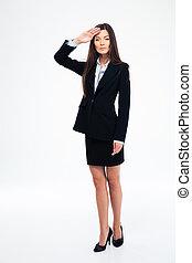 Beautiful businesswoman saluting - Full length portrait of a...
