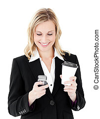 Beautiful businesswoman sending a text holding coffee