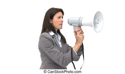 Beautiful businesswoman shouting through megaphone against a...