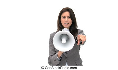 Beautiful businesswoman shouting through megaphone and pointing
