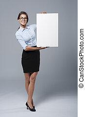 Beautiful businesswoman showing the whiteboard