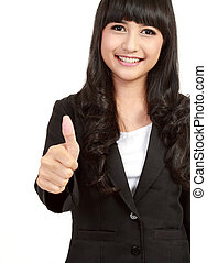 Beautiful businesswoman showing thumbs up