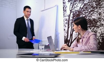 Beautiful businesswoman signing documents