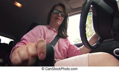 Beautiful Businesswoman Sitting Behind The Wheel