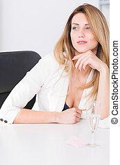 Beautiful businesswoman sitting in office - Beautiful young...