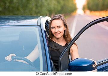 Beautiful businesswoman sitting in the car