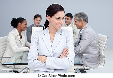 Beautiful businesswoman smiling in a meeting