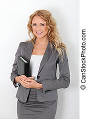 Beautiful businesswoman standing on white background with agenda