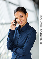 businesswoman talking on smart phone