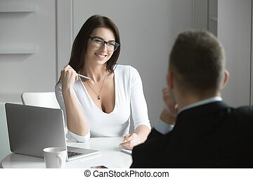 Beautiful businesswoman talking to a male job applicant