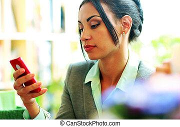 Beautiful businesswoman using smartphone