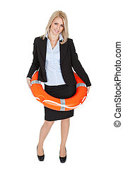 Beautiful businesswoman with life buoy