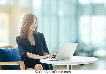 Beautiful businesswoman working at office