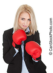 Beautiful businesswomen posing with boxing gloves