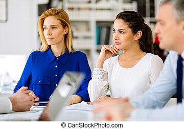 Beautiful businesswomen working in office