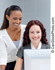Beautiful businesswomen working together in office