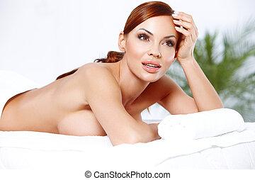 Beautiful busty woman in a spa - Beautiful busty blonde...