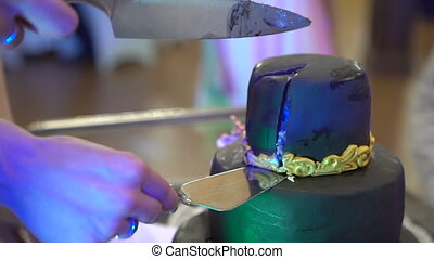 Beautiful cake cut with a knife on a stand