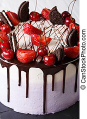 Beautiful cake with strawberry and cherry, decorated cookies...
