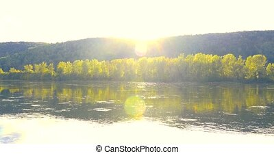 Beautiful calm mountain river in autumn at sunset on a warm ...