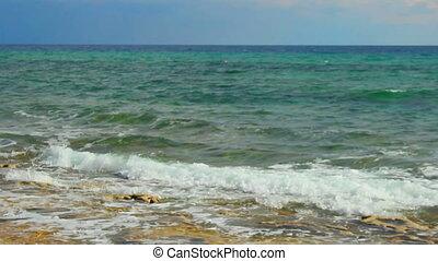 """Beautiful calm seascape, blue sea waves splashing, loopable shot for meditation"""