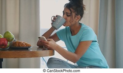 Beautiful, calm young woman with a cup of coffee, relaxing hot drink, happy lady holding a cup. Pretty brunette.Food and drink.
