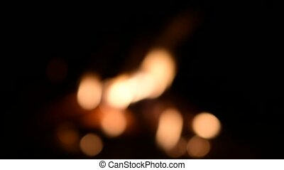 Beautiful campfire in the dark. Blurred fire flames on black background.